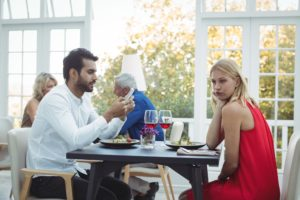 Man ignoring bored woman